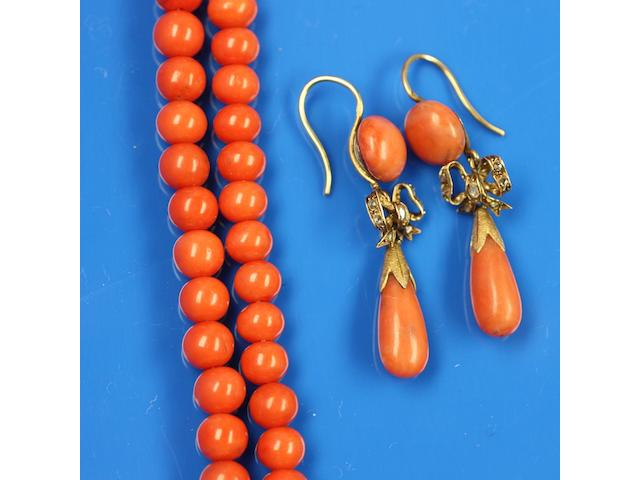 A pair of coral and diamond pendant earrings and double row coral bead necklace (3)