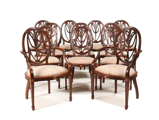 A good set of twelve late Victorian/ Edwardian carved mahogany and marquetry dining chairs possibly by Gillow and Co.