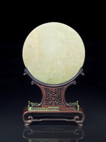 A jade circular screen with wood and stained ivory stand (incomplete)