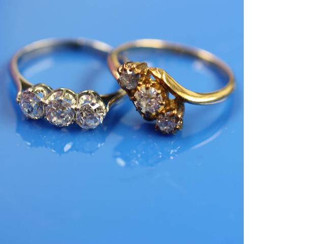 Two three stone diamond rings (2)