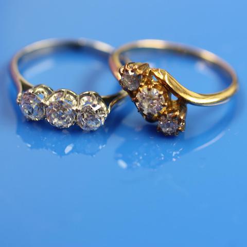 Two three stone diamond rings (2)