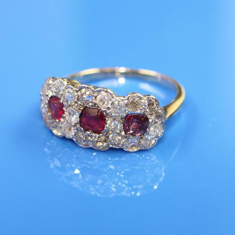 A red paste and diamond set triple cluster ring