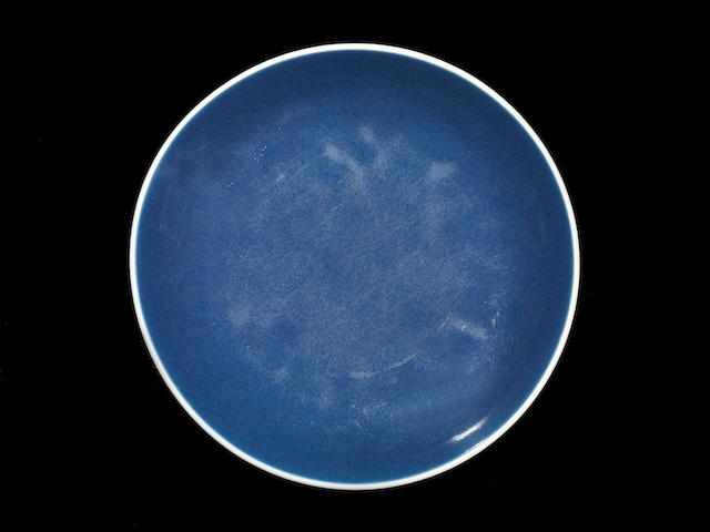 A blue-glazed saucer dish 17th century