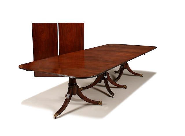A very large Regency style mahogany triple pedestal dining table