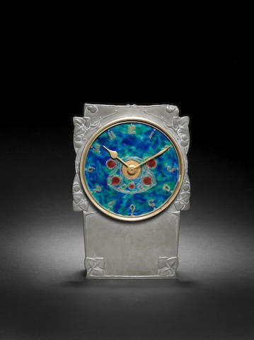 Archibald Knox for Liberty & Co. A Pewter, Copper, and Enamel Clock, circa 1905