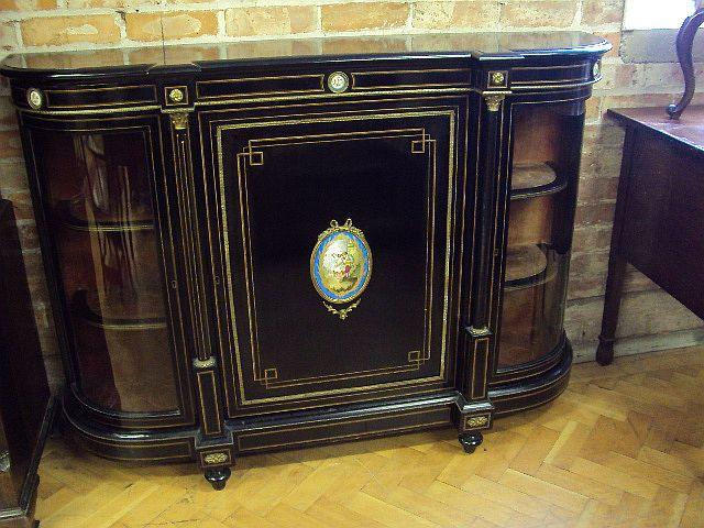 A Victorian ebonized and gilt metal-mounted bow-breakfront credenza