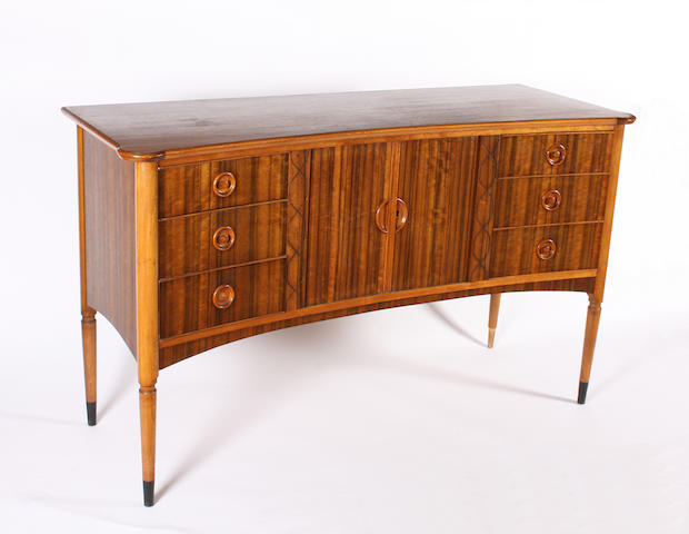 A Gordon Russell style mahogany, figured walnut veneered and beech sideboard