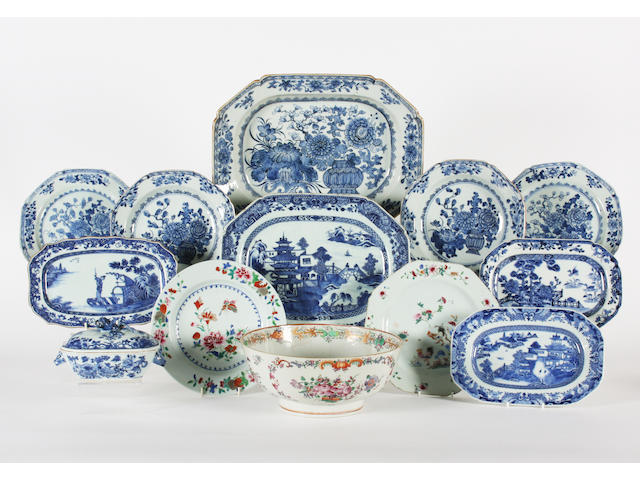 A Chinese blue and white part dinner service, a group of matched blue and white pieces, a famille rose bowl and three plates 18th Century.