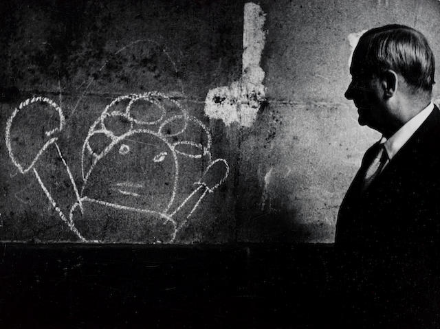 Brassaï (Gyula Halász) (Hungarian/French, 1899-1984) Miró looking at a graffiti, 1955