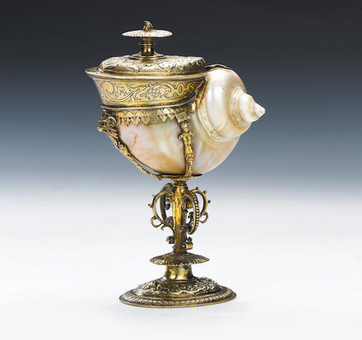 "A late 16th / early 17th century Continental silver-gilt mounted turban shell nautilus cup and associated cover, stamped with three lozenges within a shield shaped punch, another mark mistruck, possibly Utrecht and ""K"" within a shaped punch, cover unmarked,"