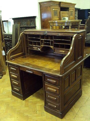 A walnut tambour-top pedestal desk, early 20th Century The escutcheon reading 'Derby Desk, Thomas Turner, 44 Holborn Viaduct, London'