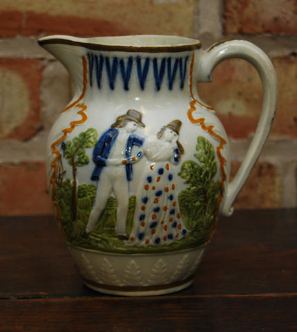 A prattware 'Sailor's Return' jug, circa 1800