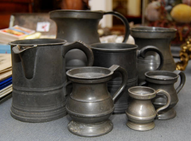 A group of 19th century pewter mugs