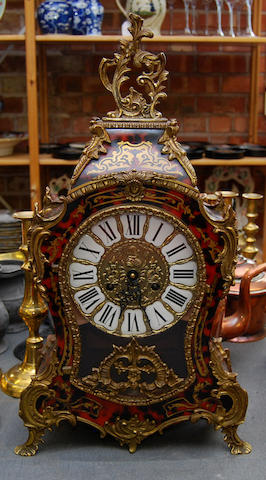 A 20th century French red boulle and brass bracket clock