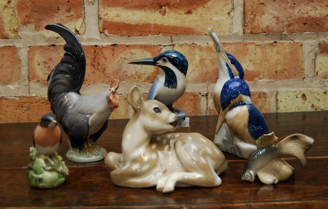 A collection of thirteen Royal Copenhagen animal and bird figurines