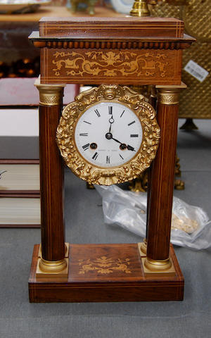A late 19th century French inlaid rosewood portico clock