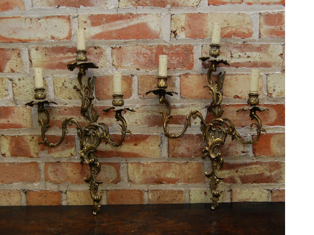 A pair of rococo-style gilt-metal wall fittings
