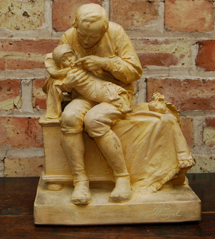A terracotta figure group of a man and child