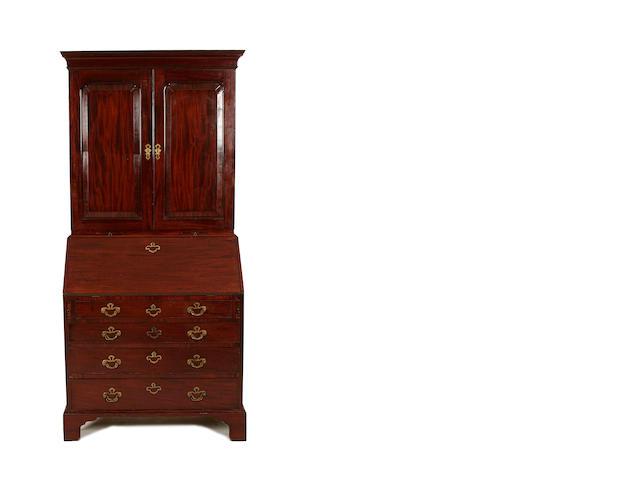 A George II mahogany bureau cabinet
