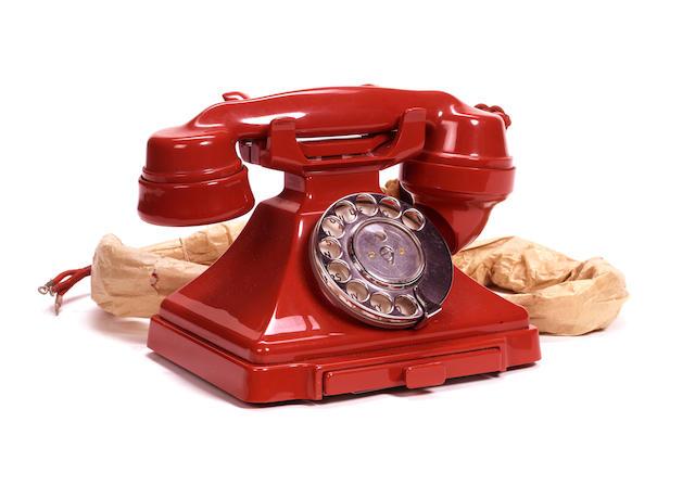 An unused near-mint 200-series red bakelite telephone, impressed mark 164 56,