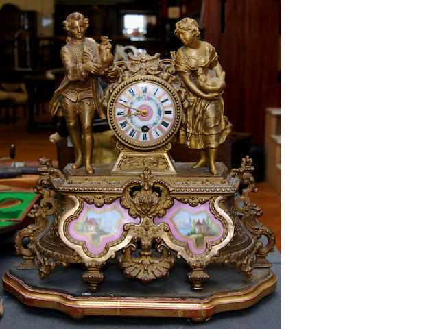 An ormolu mantel clock