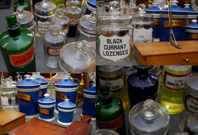 A collection of glass pharmacy bottles and jars