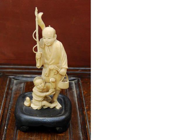 A Japanese ivory okimono of a fisherman
