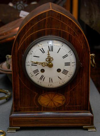 A rosewood mantel clock