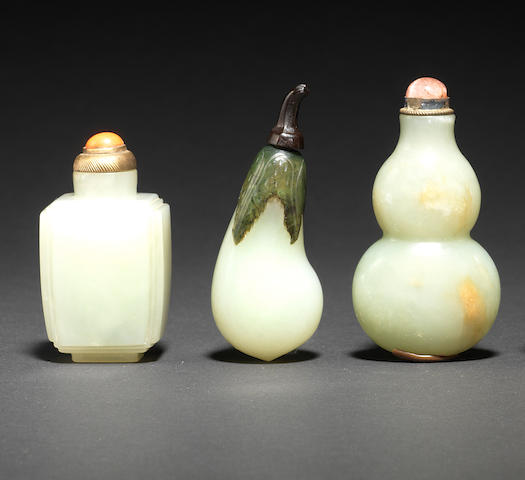 Three white and pale green jade snuff bottles 19th century