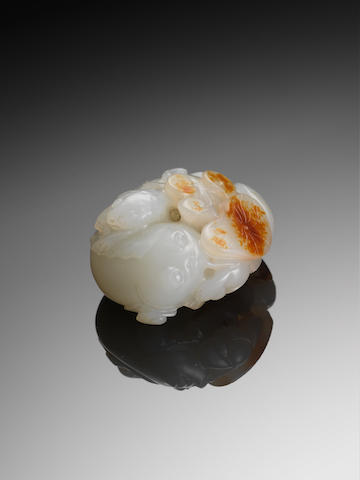 A white and russet jade 'fish' group 18th/19th century