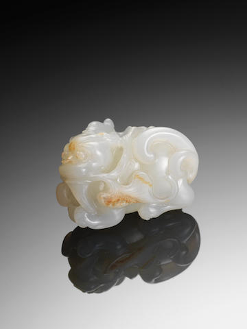 A white and russet jade qilin 19th century