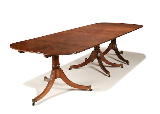A George III style triple pedestal mahogany dining table