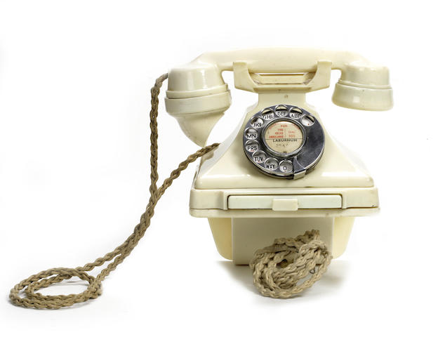 A rare 200-series telephone and wall bracket in ivory bakelite, impressed mark S-38 GPO No. 164 234,