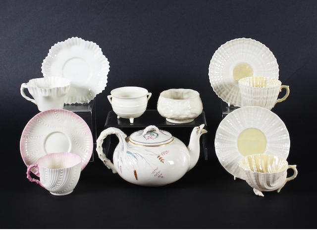 A Belleek teapot and cover, four cups and saucers and two bowls Circa 1863-1965.