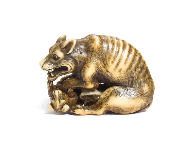 An ivory netsuke of a yama-inu (wild dog) By Tomotada, Kyoto, late 18th century