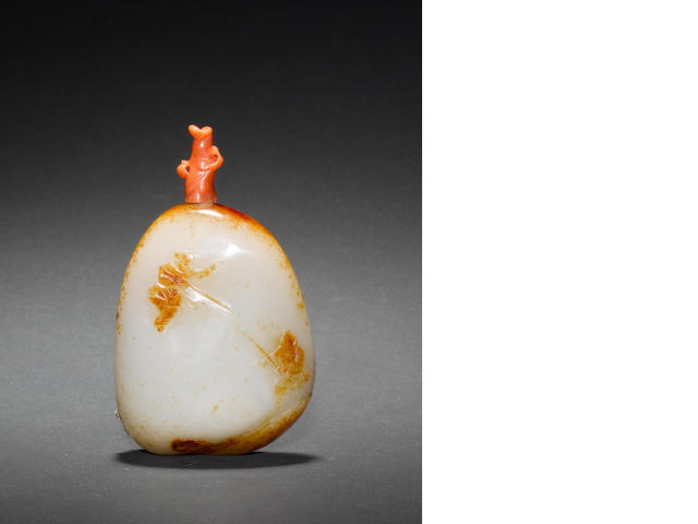A mottled pebble jade snuff bottle; with stopper
