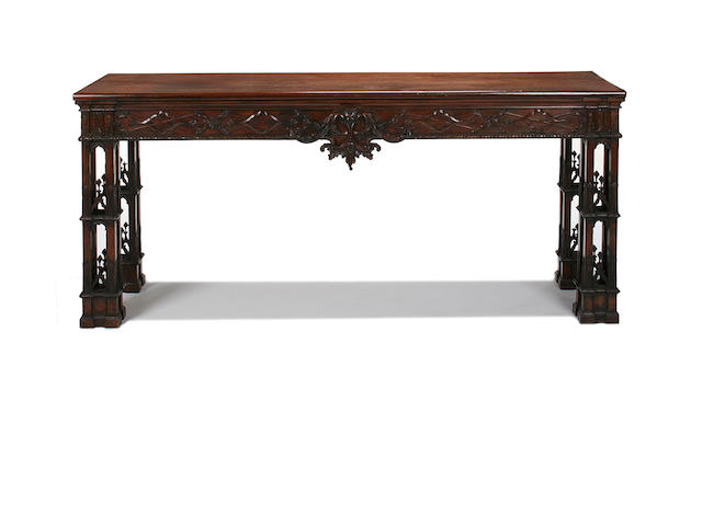 An early 20th century carved mahogany side table after a design by Thomas Chippendale