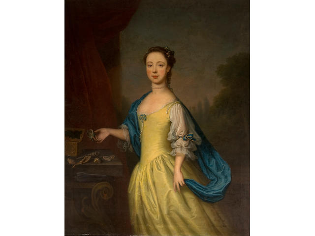 Thomas Bardwell (British, 1704-1767) Portrait of a girl, three-quarter length, in a yellow dress and blue shawl, holding a shell in her right hand and standing by a table with a view to a landscape beyond