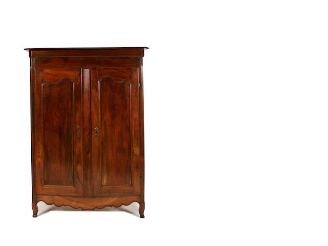 A French provincial late 18th/early 19th century walnut armoire