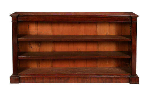 An open fronted inverted mahogany bookcase