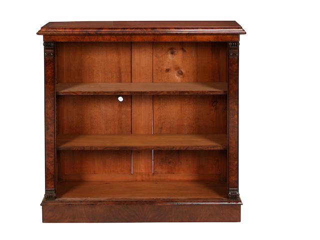 A small walnut and figured walnut open bookcase