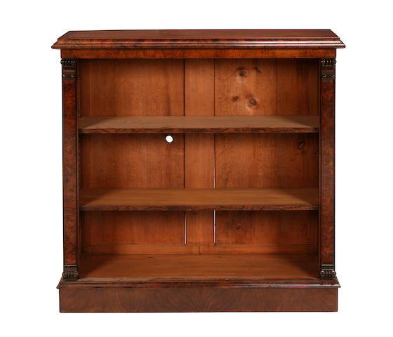 A small walnut and figured walnut open bookcase