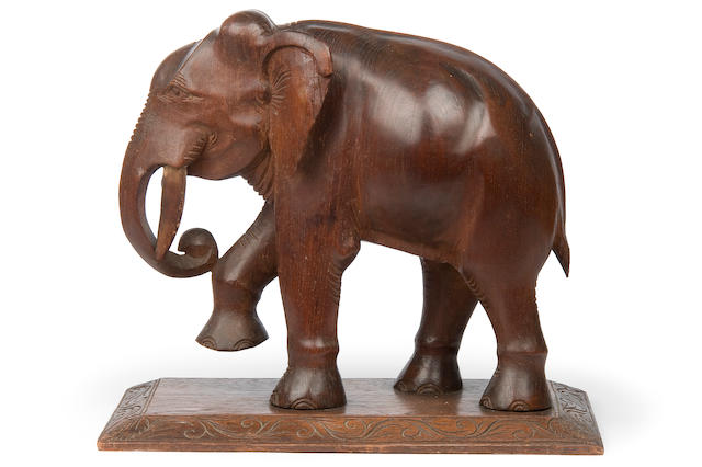 An African carved wooden elephant