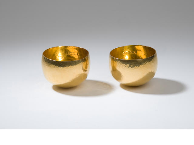 A pair of 22 carat gold cups  by RNRG London 1973