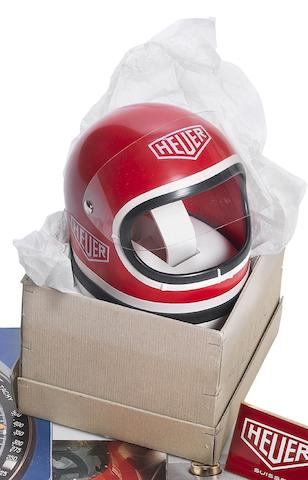 A rare Heuer Helmet watch display box in original packaging
