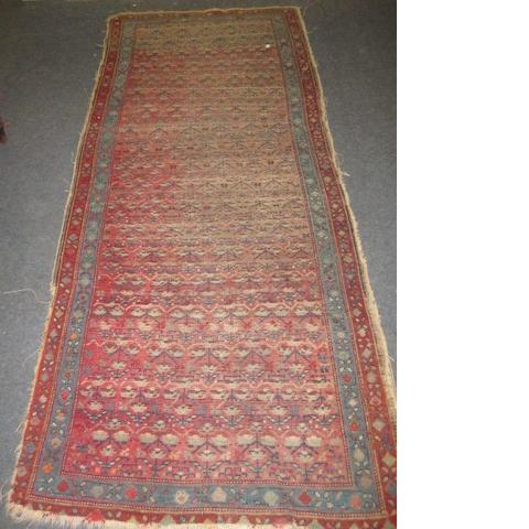 A South Caucasian runner, with repeated stylised foliate design on an abrashed field, 2.45 x 1m, an Afshar rug, a North West Persian rug, and a Pakistan Bokhara rug.(4)