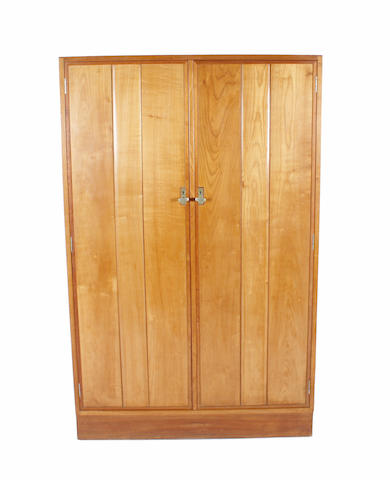 A Gordon Russell cherry and walnut double wardrobe, designed by Eden Minns, no. 970, circa 1931