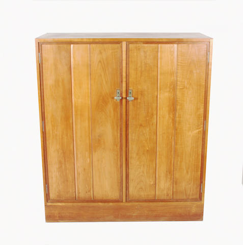 A Gordon Russell cherry and walnut cabinet, designed by Eden Morris, no. 641, circa 1931