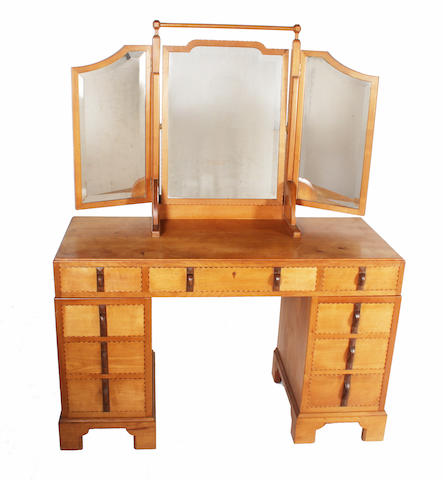A Gordon Russell cherry, walnut and boxwood chequer line edged kneehole twin pedestal dressing table, designed by Gordon Russell, no. 685/991, circa 1931