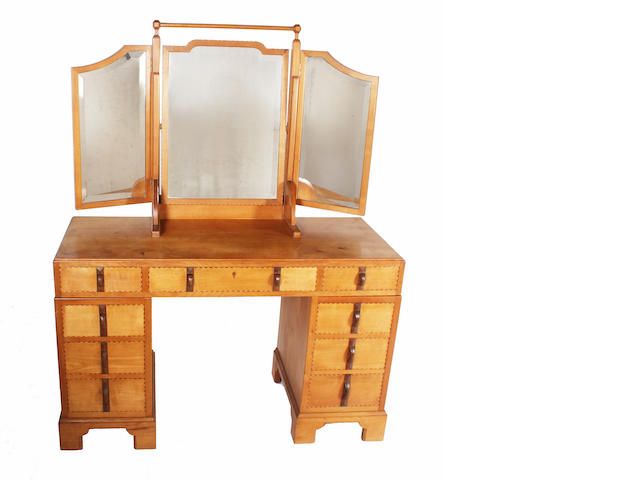 A Gordon Russell cherry, walnut and boxwood inlaid dressing table, designed by Gordon Russell, no. 685/991, circa 1931